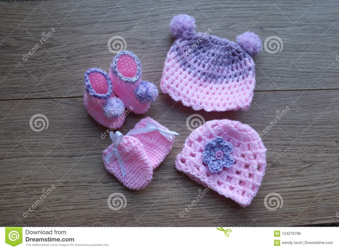 6f0d3a48b0f Pink and lilac yarn used to crochet baby hat mittens and botties.hat has  flower and Pom Pom