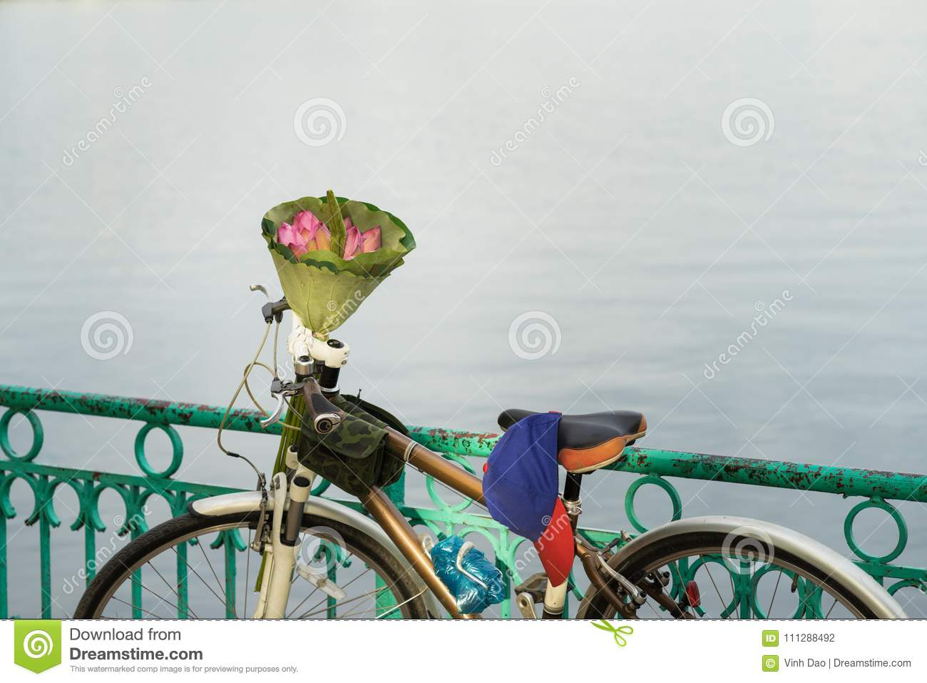Pink Lotus Flowers Bouquet Made Of Lotus Leaves On Bike By Lake