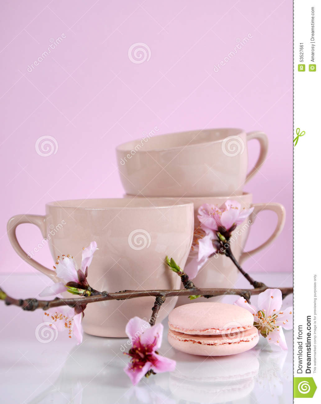 Pink macaron cookie with vintage cups