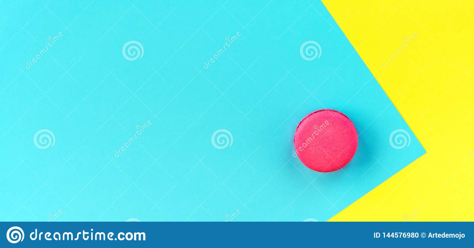 Pink macaroons on a yellow and blue background