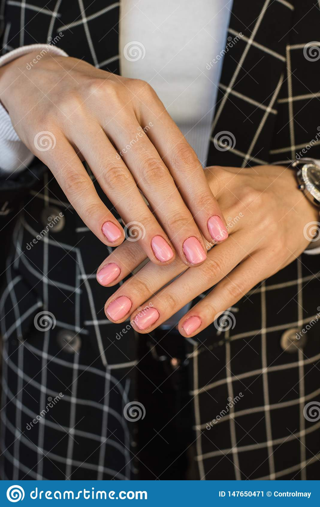 Pink manicure of the girl