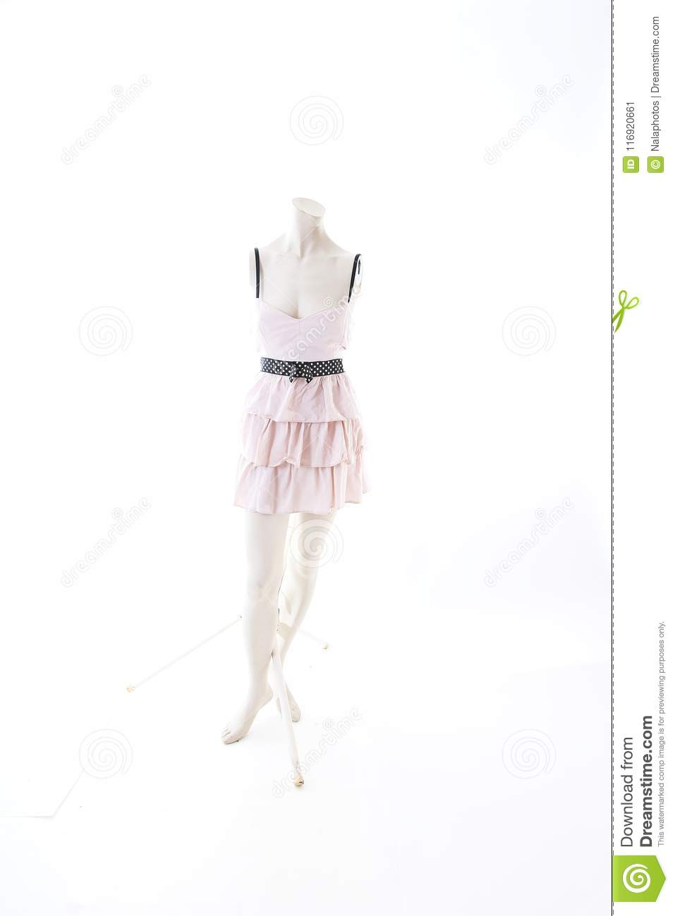 Pink short mini dress on mannequin full body shop display. Woman fashion styles, clothes on white studio background.