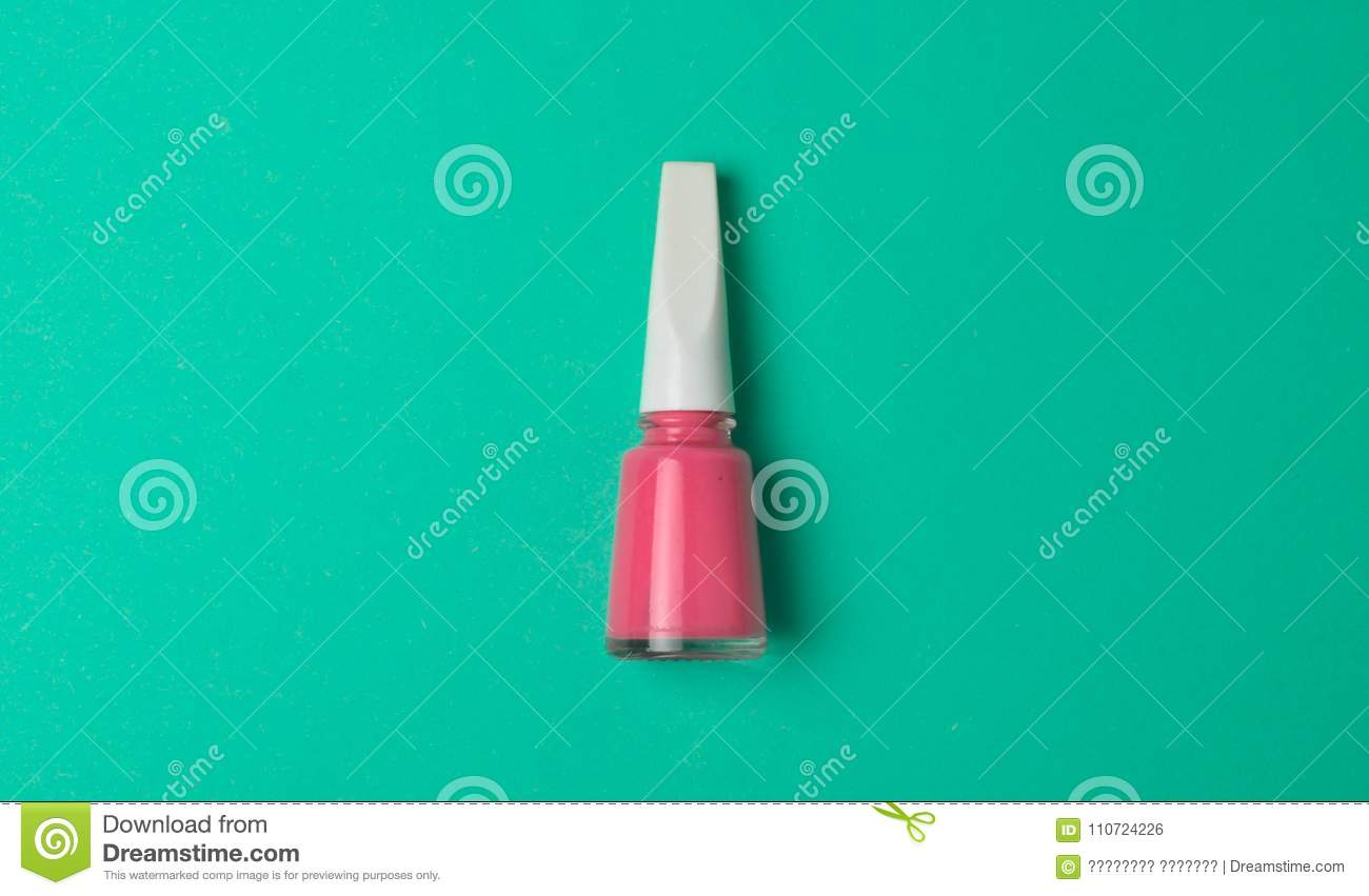 Pink Nail Polish On A Mint-colored Background. Top View. Minimalism ...