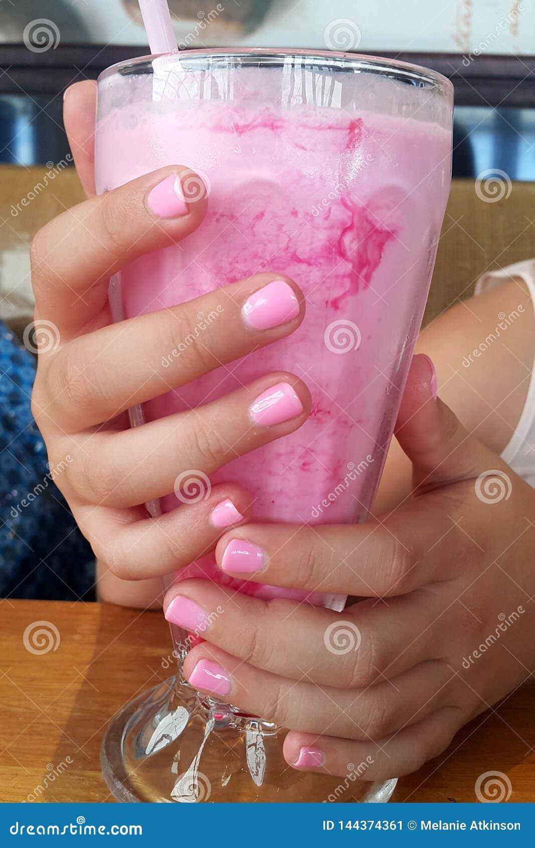 Pink nails to match the pink milkshake