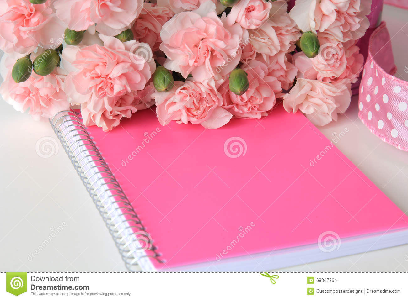 A pink notebook with a miniature beach watercolor painting.