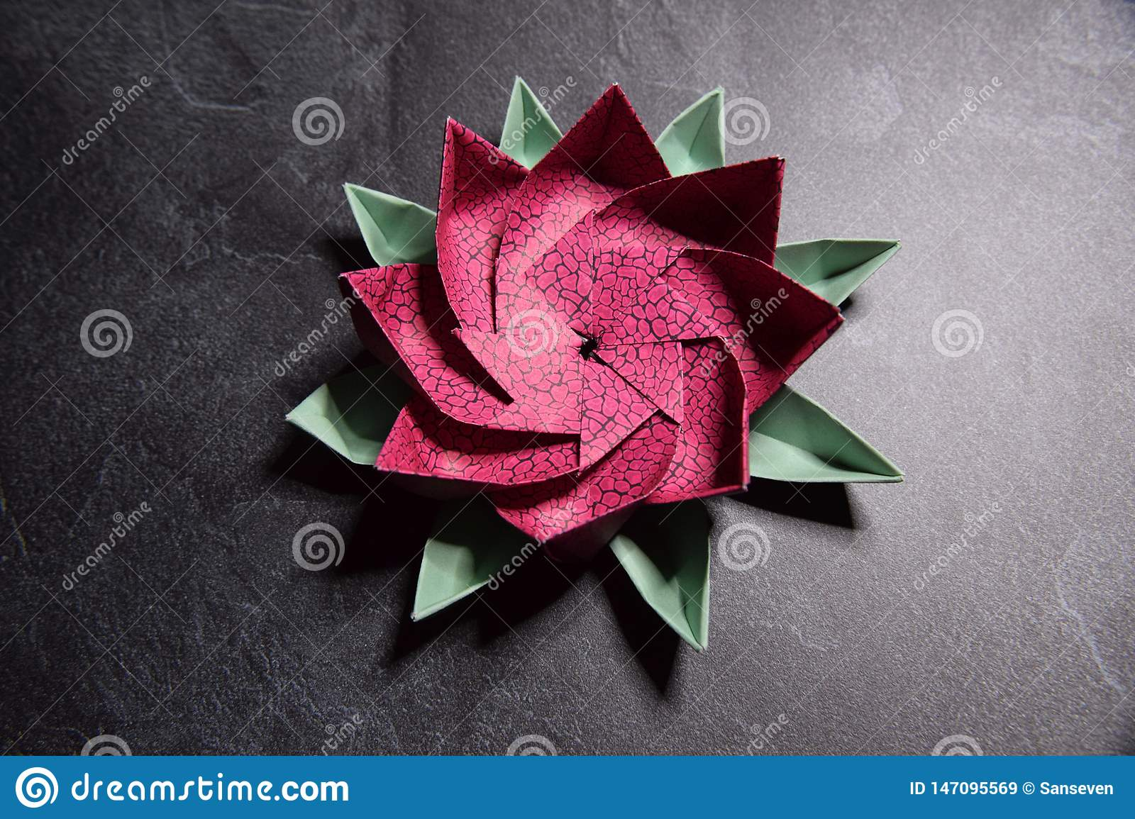 Pink Origami Lotus Flower Paper Art On Textured Background Stock