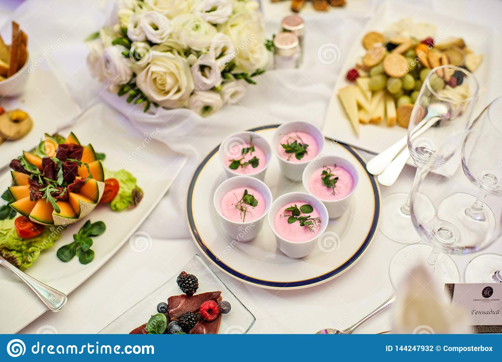 Pink Panna cotta in cups. Banquet table in the restaurant.