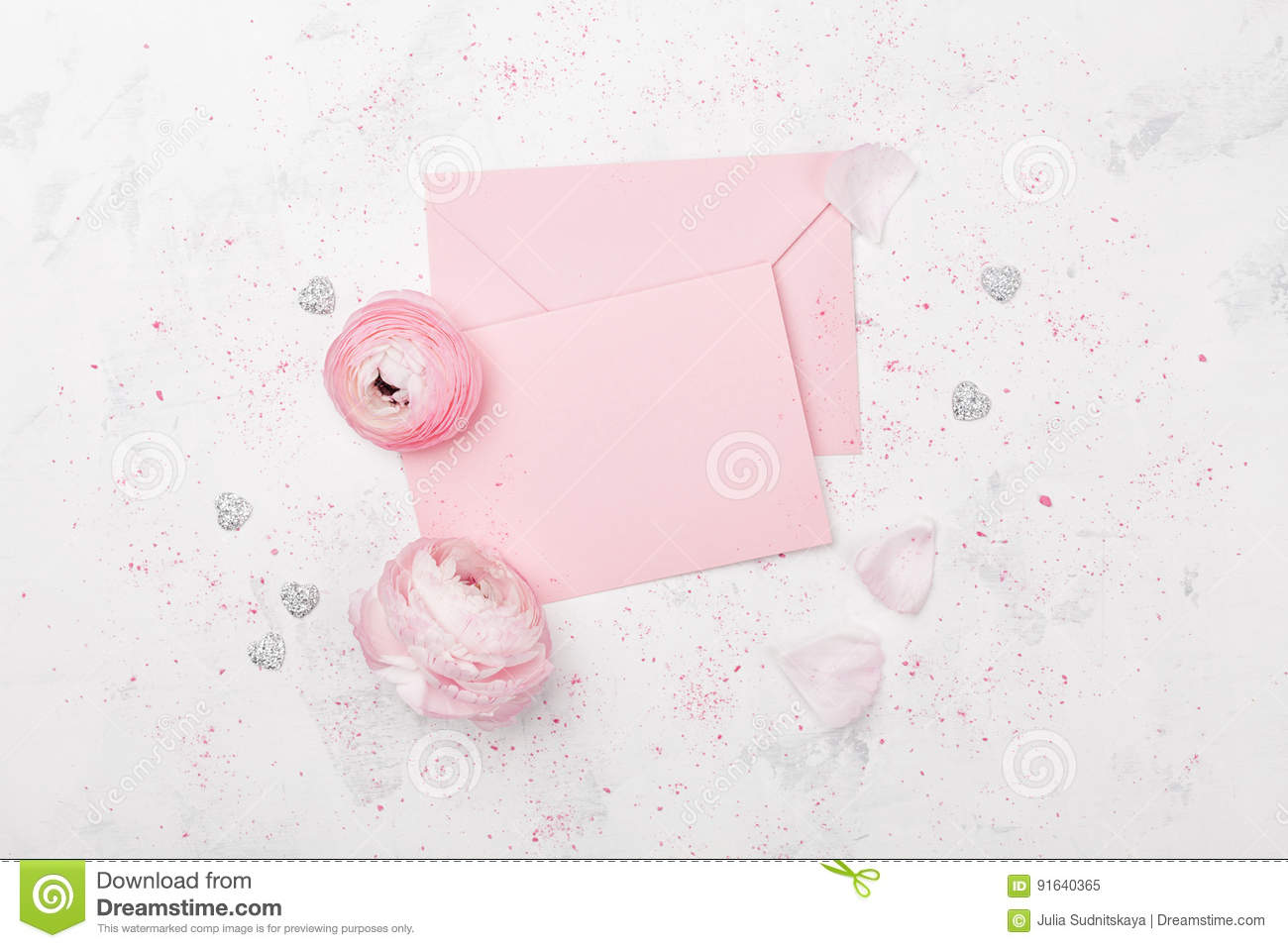 White Table Top View On Pink Paper Blank And Ranunculus Flower On White Table Top View For Wedding Mockup Or Greeting Paper Blank And Ranunculus Flower On White Table Top View For