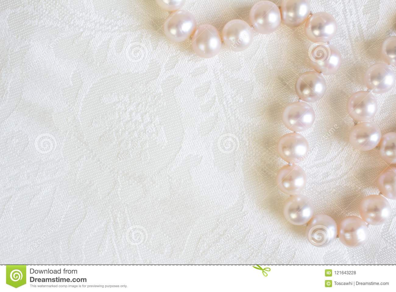 17152241b9ed94 Pink pearl necklace isolated on white silk satin textured background close  up