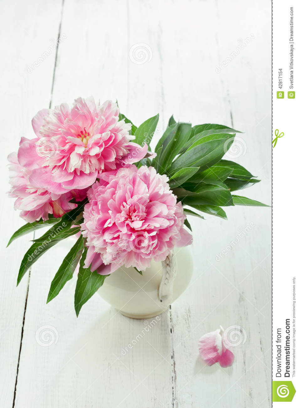 Pink Peonies In Retro Vase On Wooden Table Stock Photo