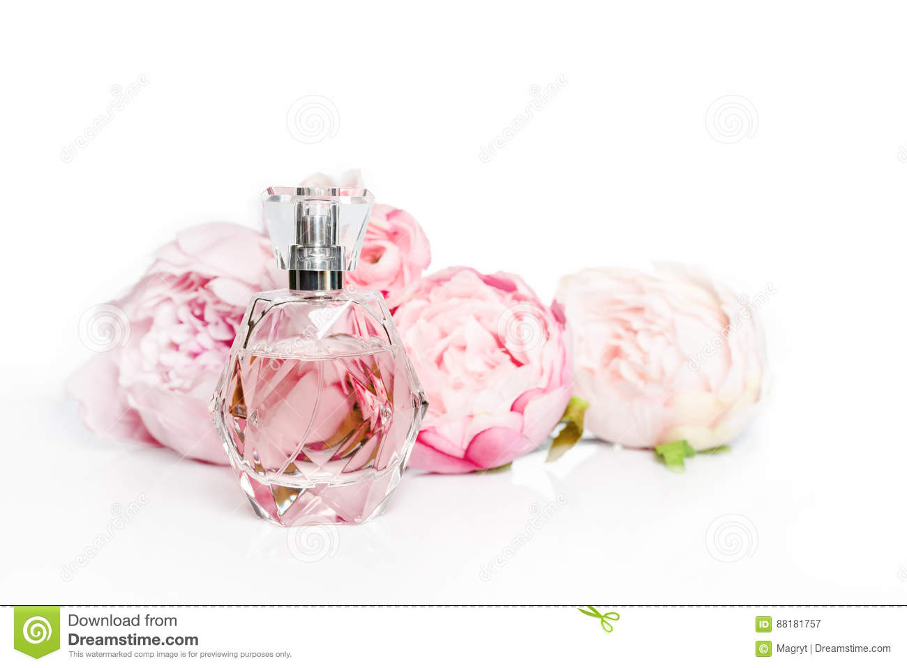 Pink Perfume Bottle With Flowers On Light Background Perfumery