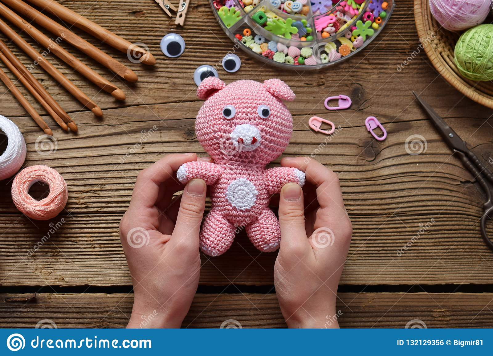 Pink Pig Crochet Toy For Child On Table Threads Needles Hook