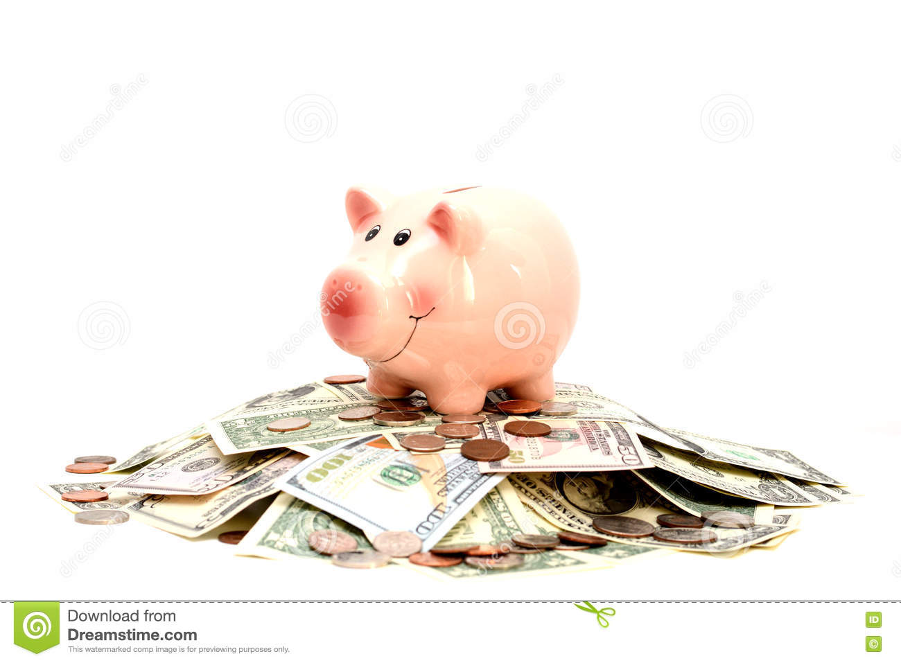 Pink piggy bank standing on a pile of coins and bills, suggesting money savings