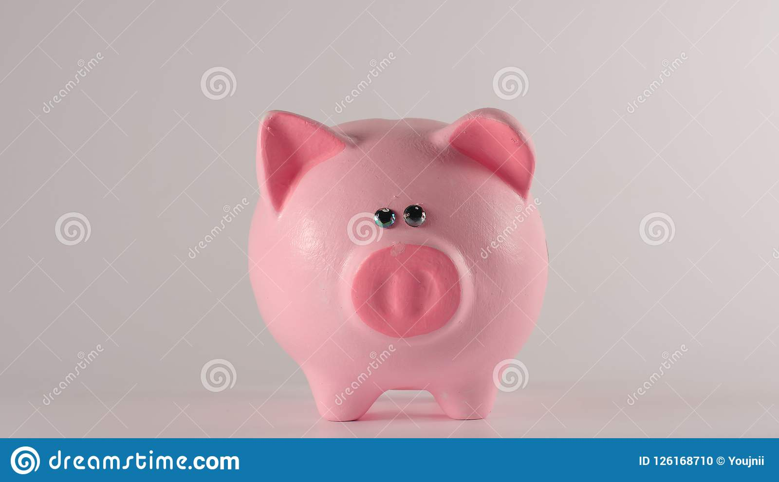 Pink piggy moneybox on a white background - Front view