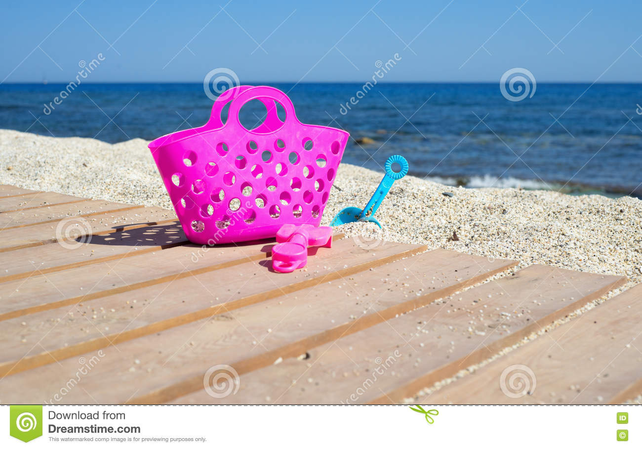 Pink Plastic Beach Bag And Other Toys Stock Photo - Image: 75495520