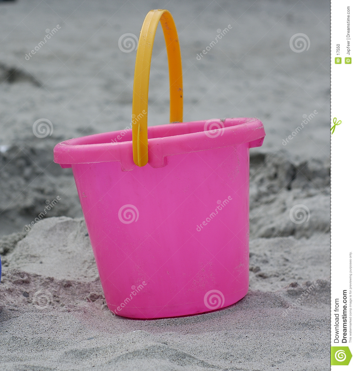Pink Plastic Bucket in the Sand