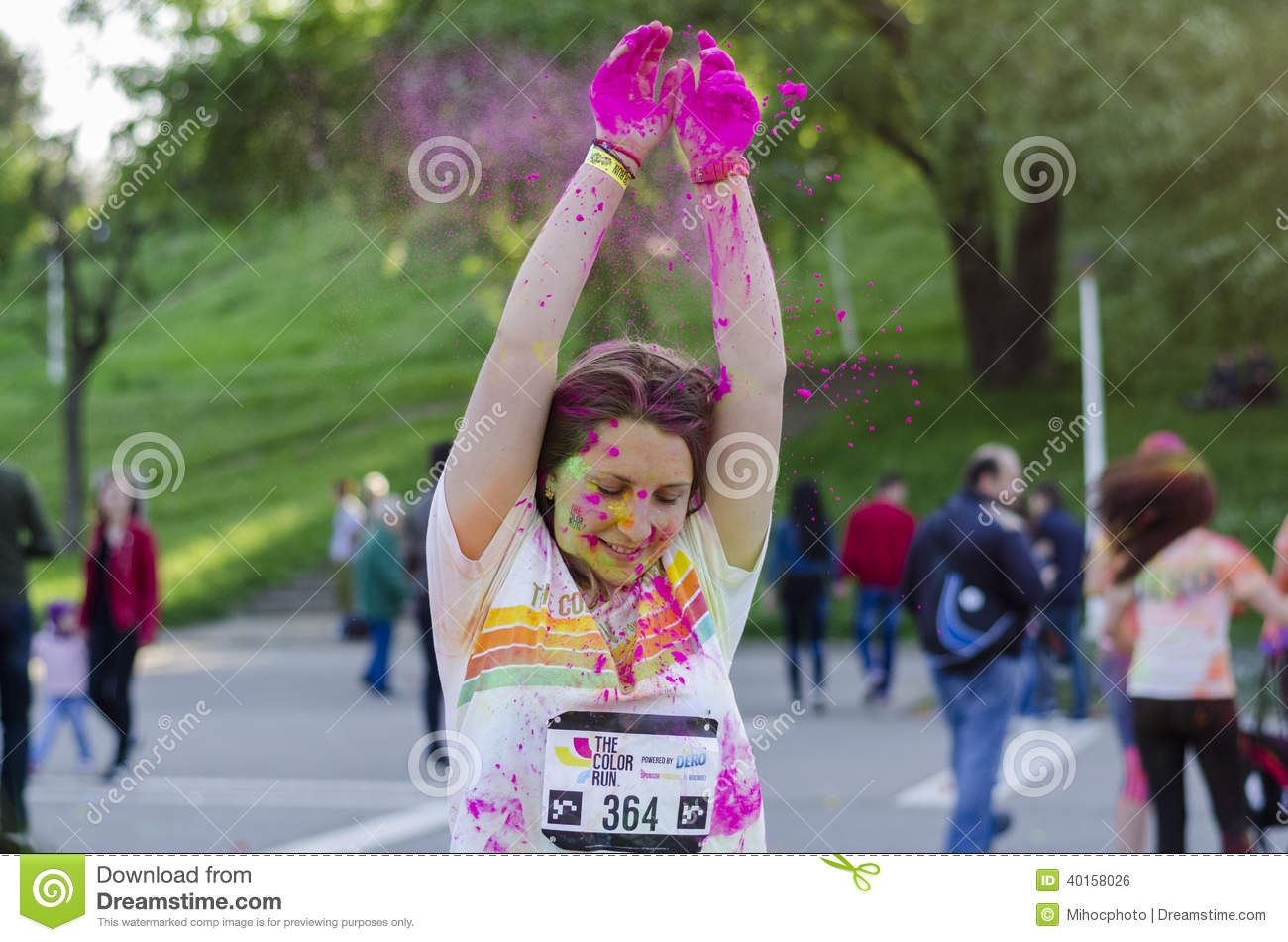 Pink powder falling on girl's head at Color Run
