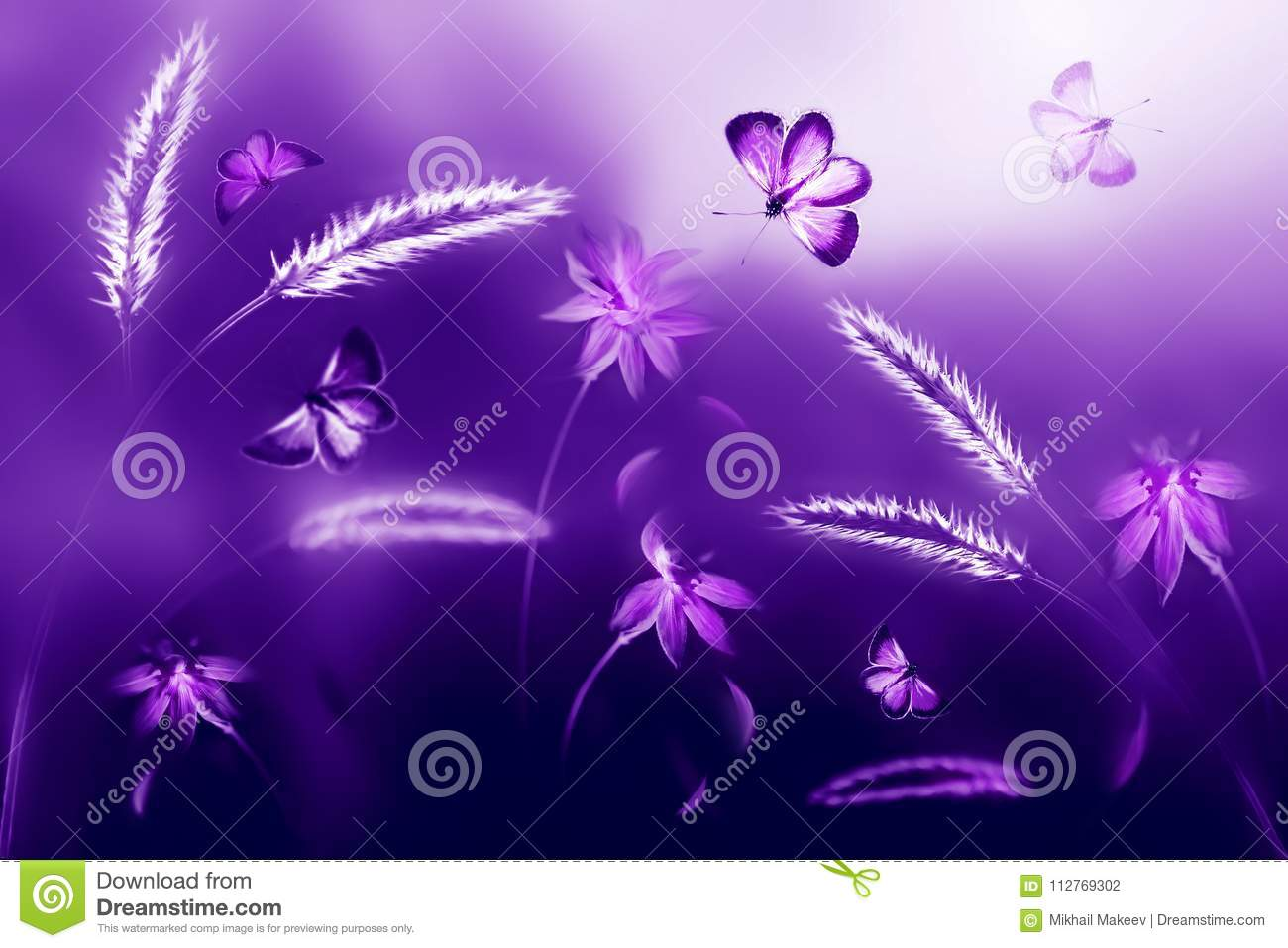 Pink and purple butterflies against a background of wild flowers in purple and violet tones. Artistic ultraviolet natural image.