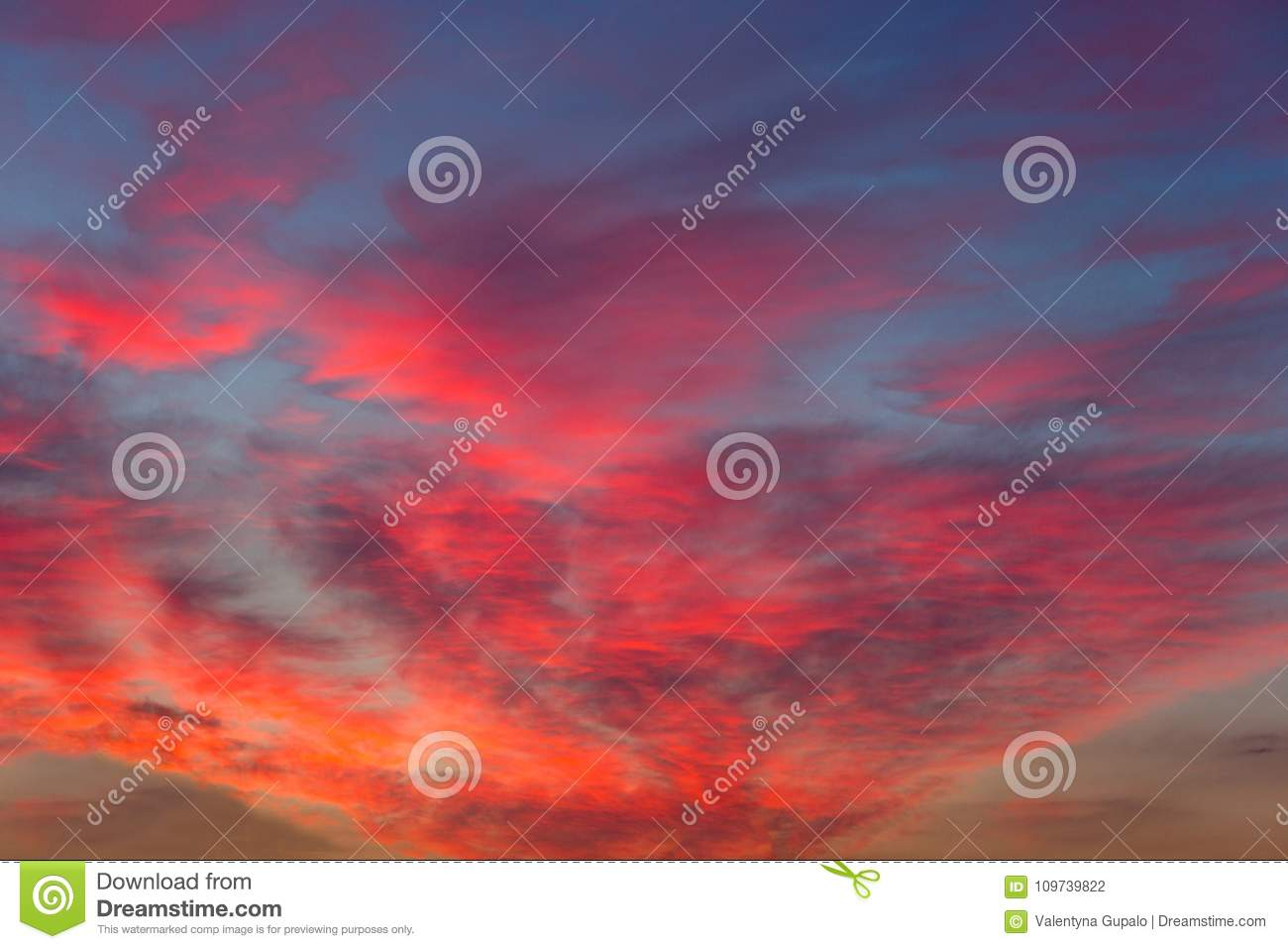 Pink purple sunset clouds on a blue sky. Colorfull abstract background