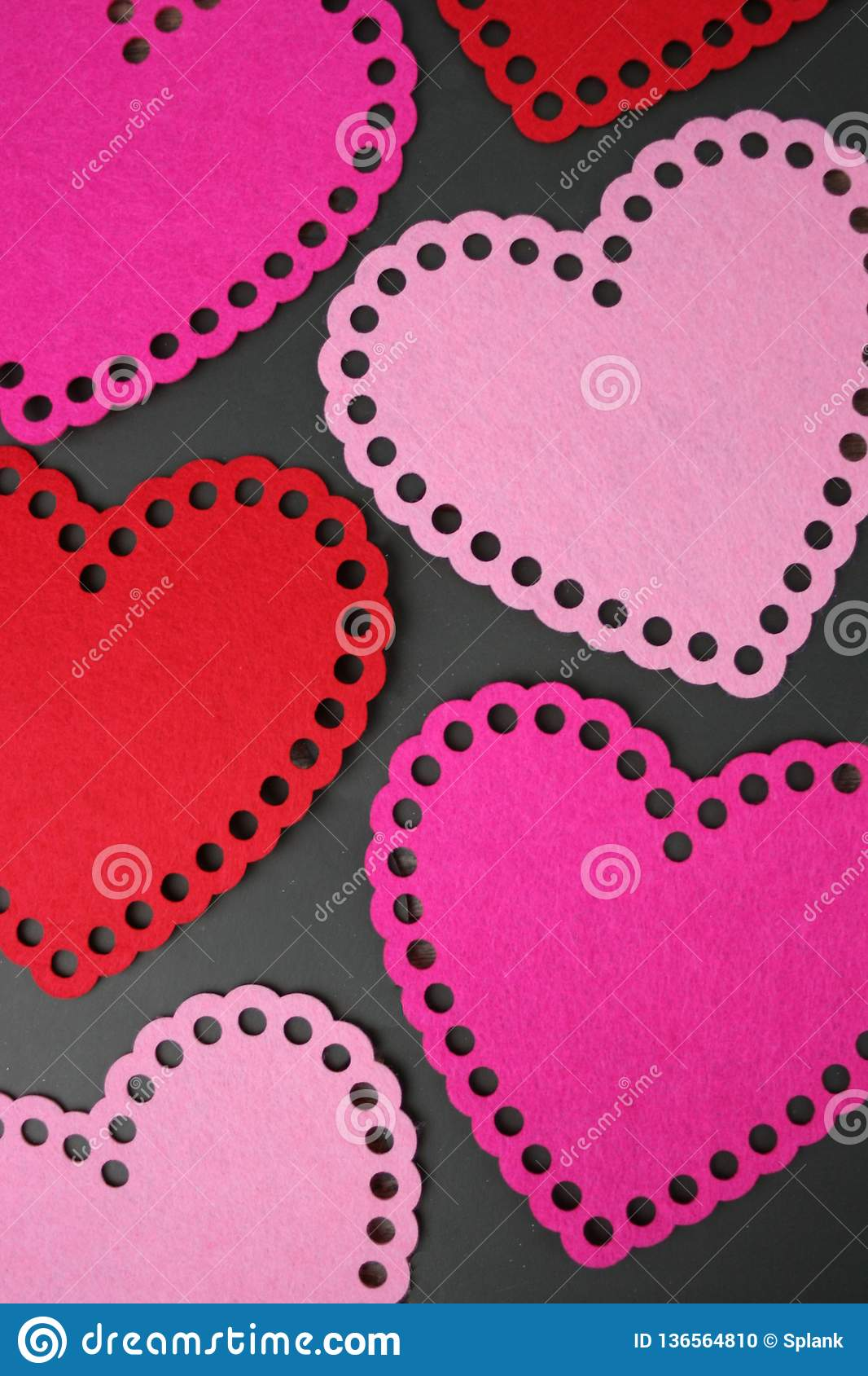 Pink and Red Hearts Over Black Background