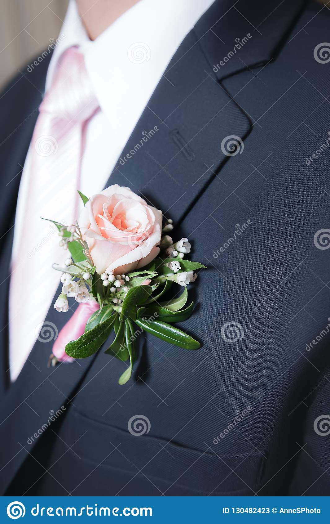 80aa61d5dd8d A Pink Rose Boutonniere On A Man`s Navy Jacket. Stock Image - Image ...