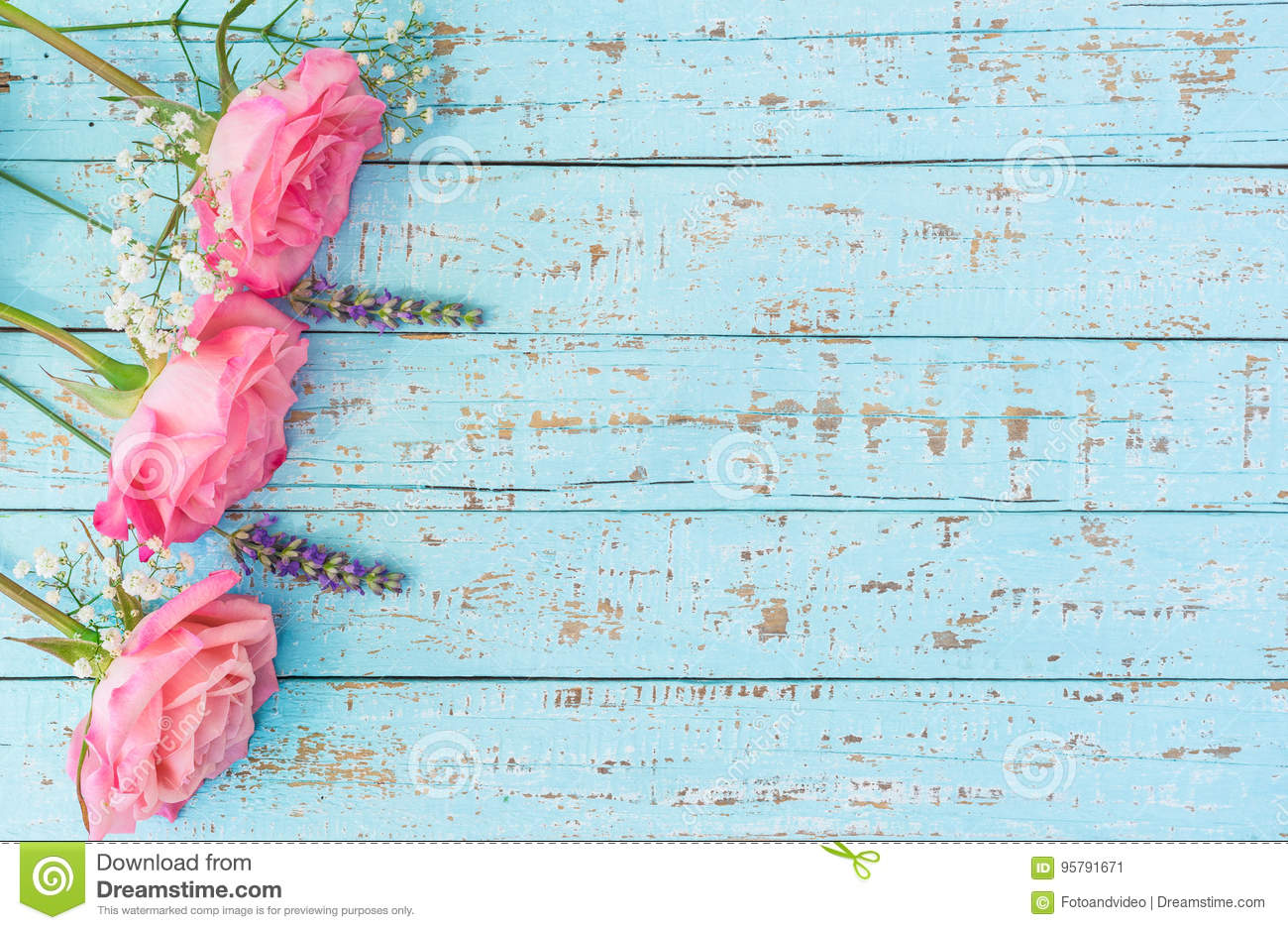 Pink Roses And Lavender On Light Blue Wood Stock Image