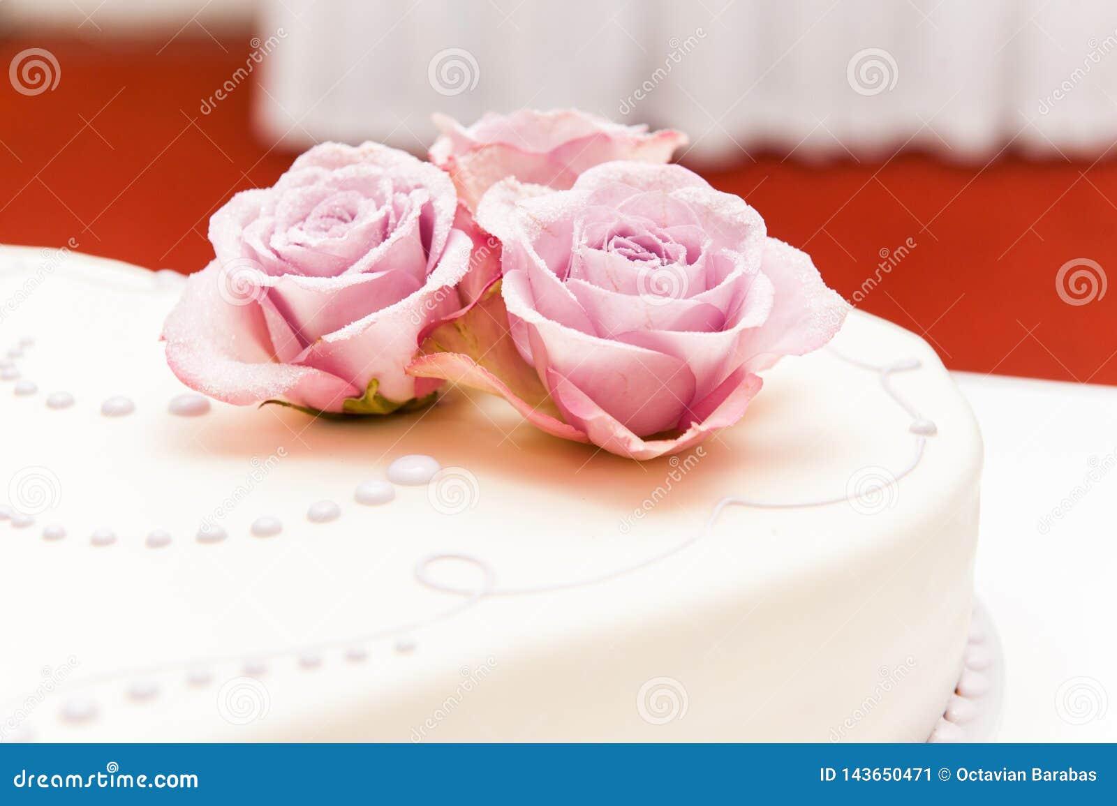 Pink roses made of sugar on wedding cake