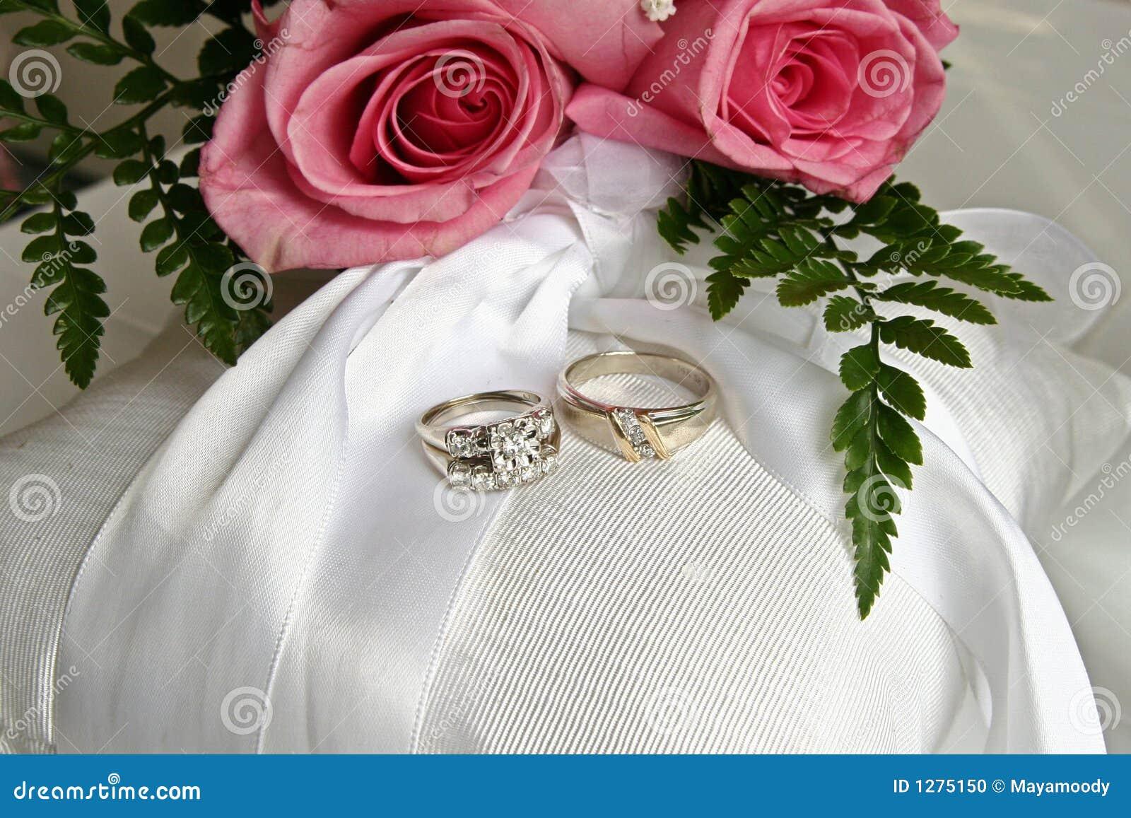 stock photo pink roses wedding rings image pink wedding rings Pink roses and wedding rings