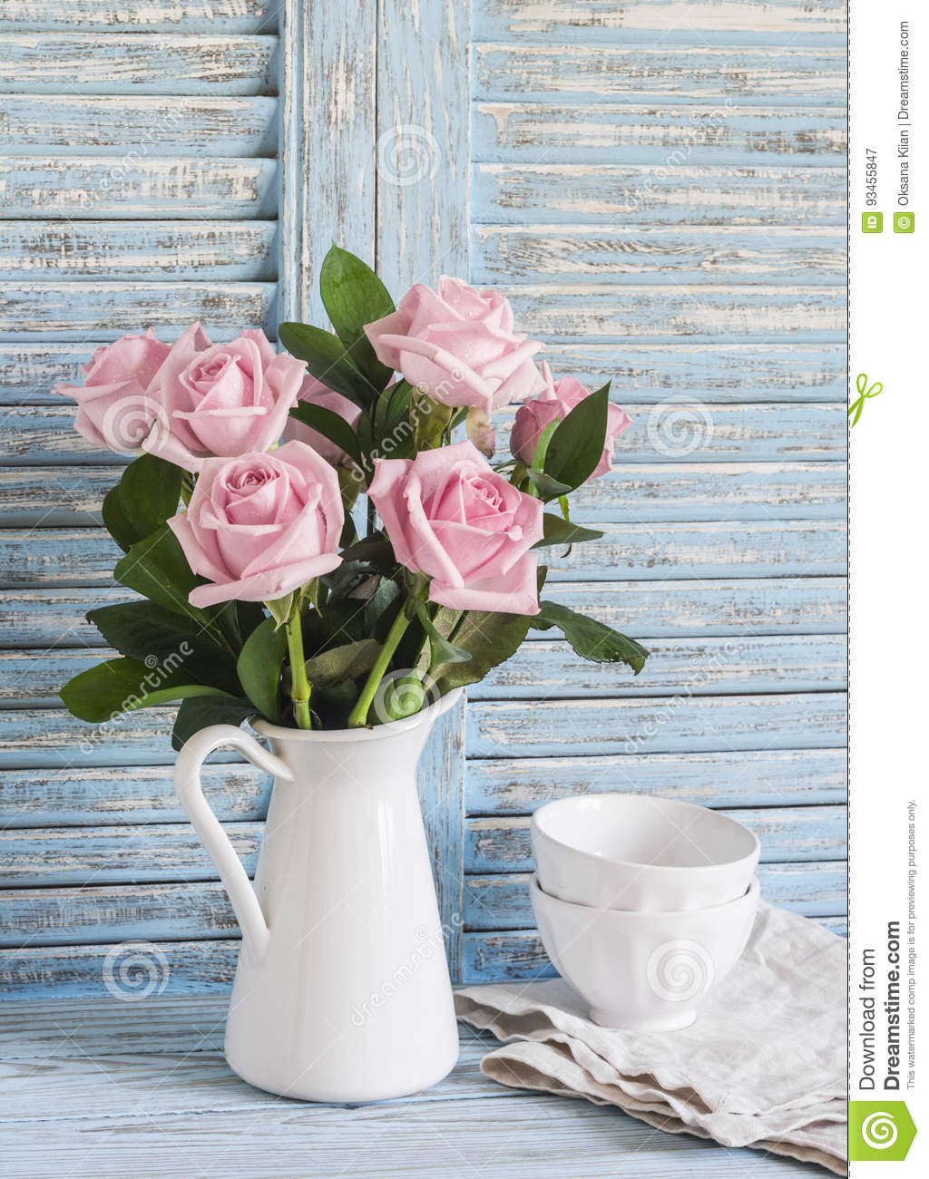 Pink Roses In A White Enameled Pitcher And Ceramic White Bowls On ...