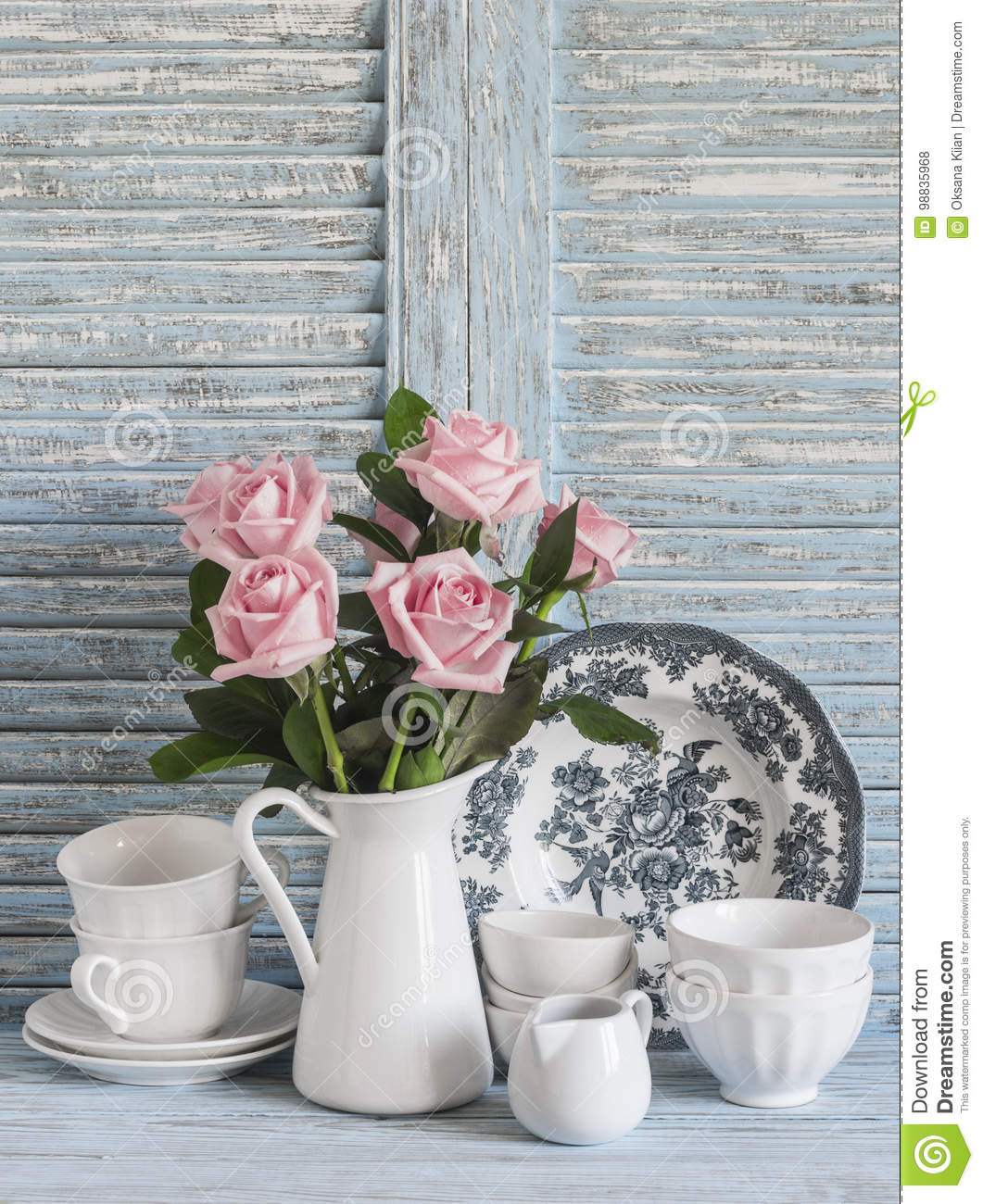 Pink Roses In A White Enameled Pitcher, Vintage Crockery On Blue ...