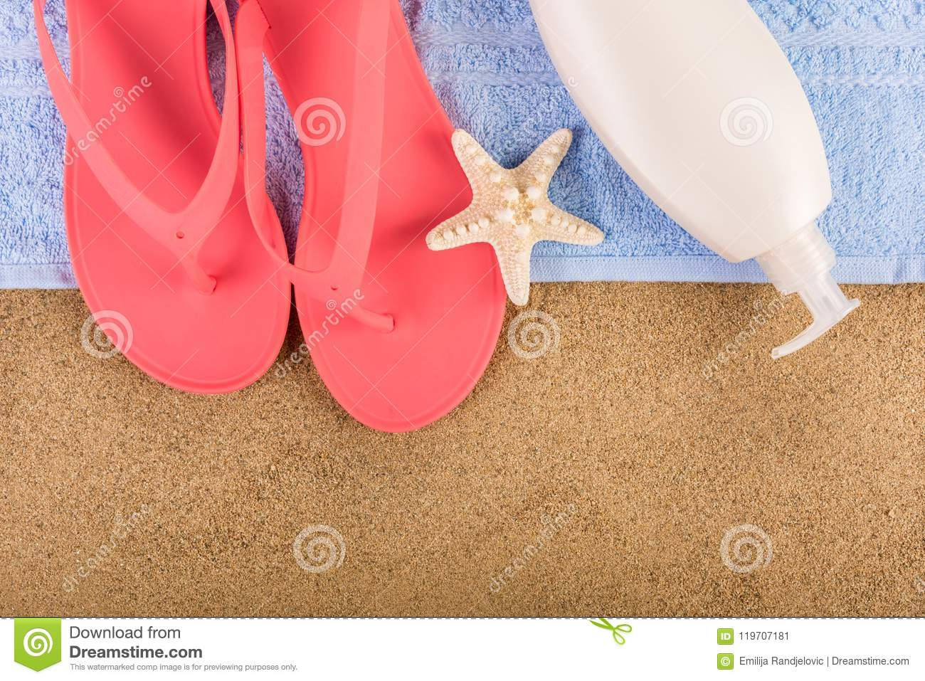 a63f28ece8d4a Beautiful female pink gently sandal flip flop on blue towel and suntan  cream lotion on sand beach and starfish. Summer vacations copy space and  concept.