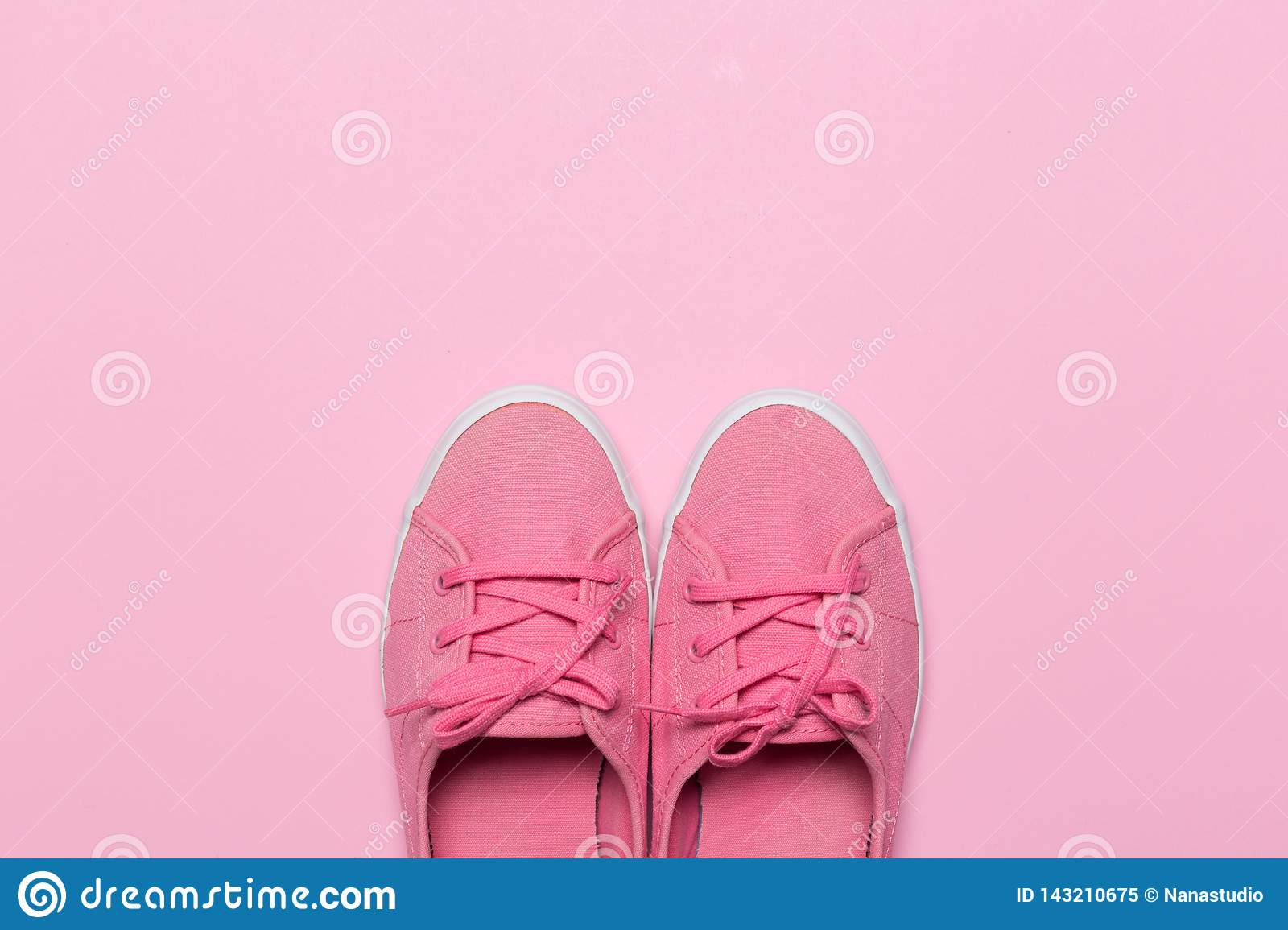 Pink shoes on a pastel background. Top view.