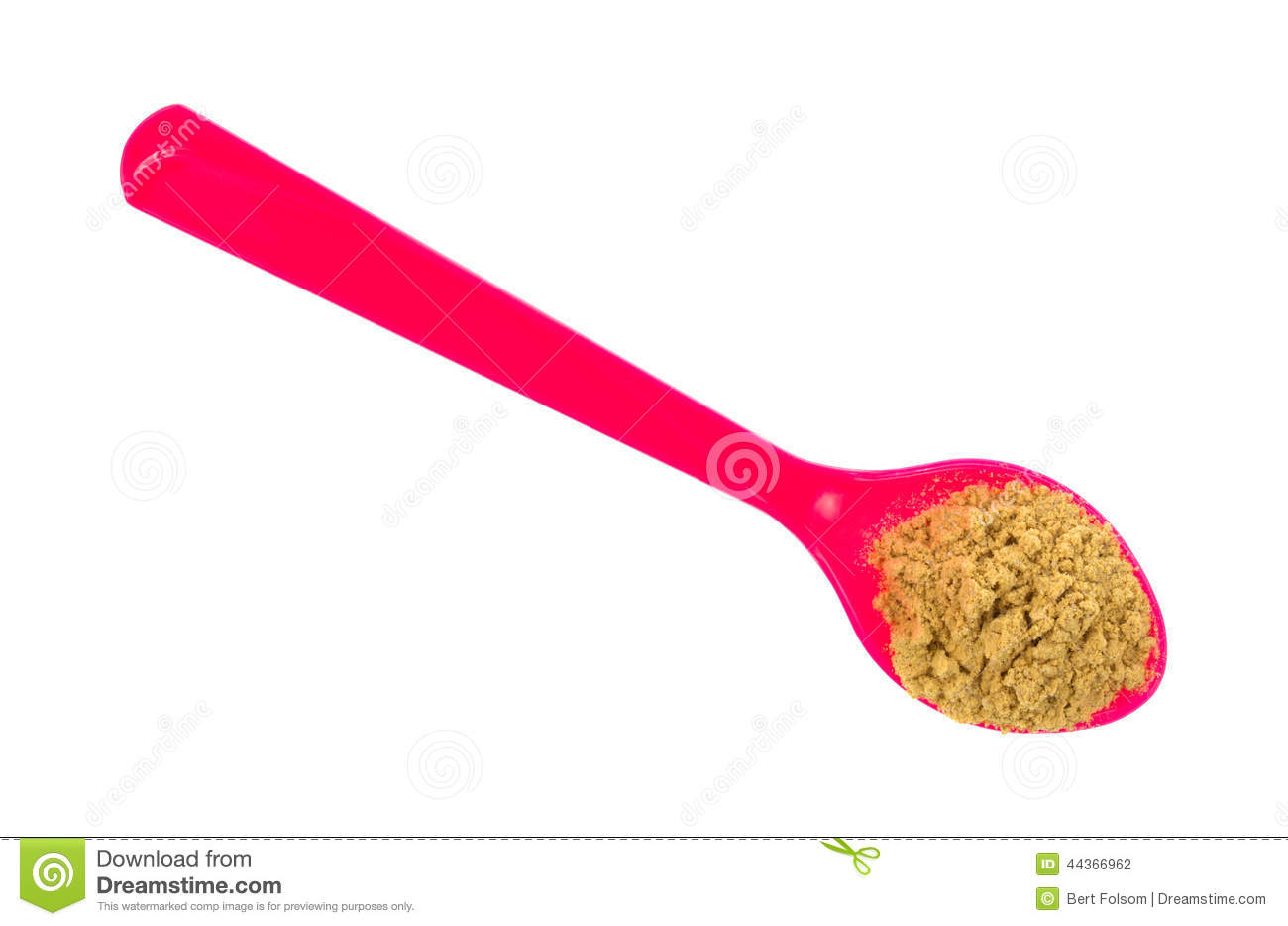 Pink spoon with stir fry seasoning on a white background