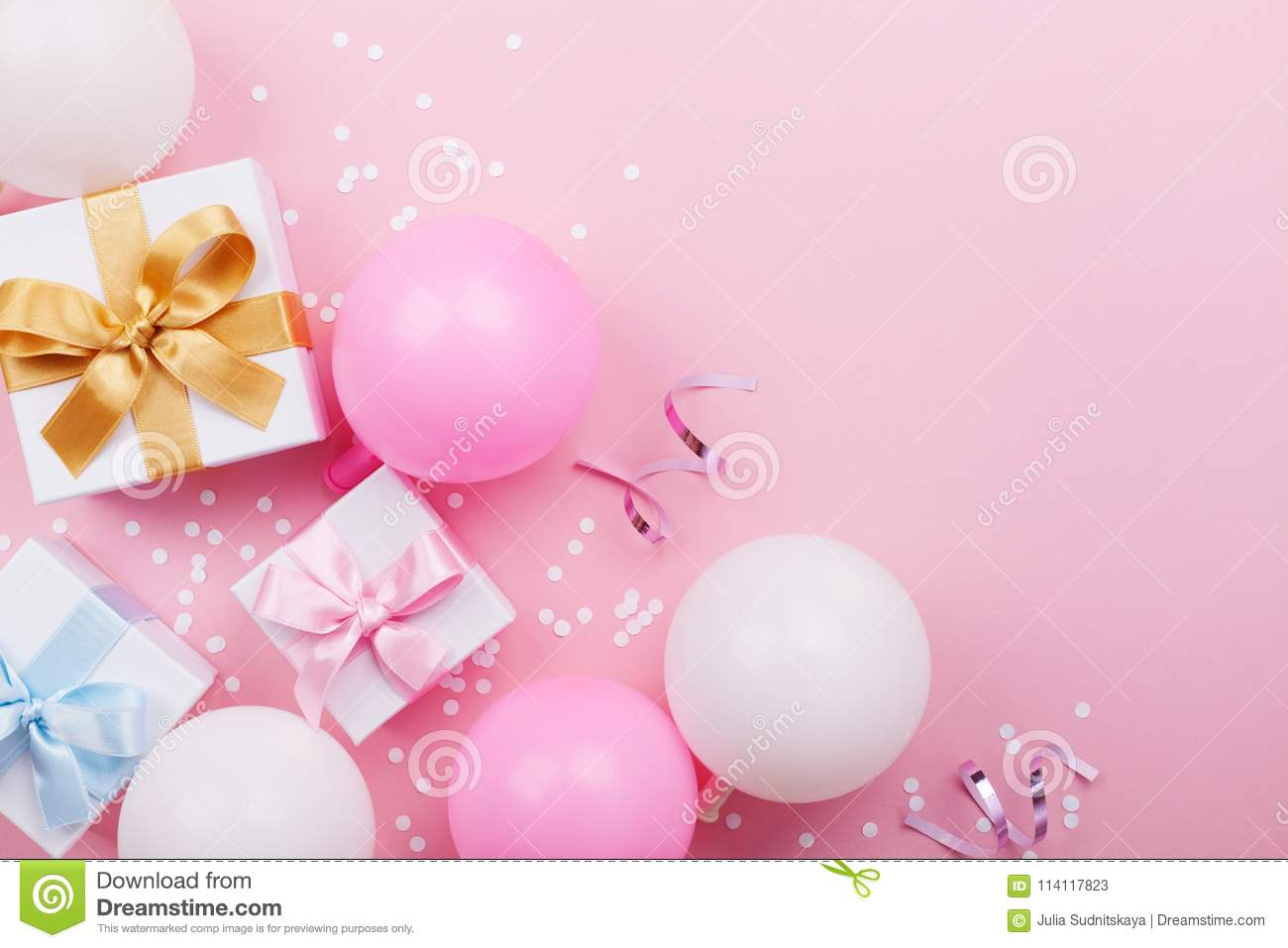 Pink Table With Balloons Gift Or Present Box And Confetti Top View