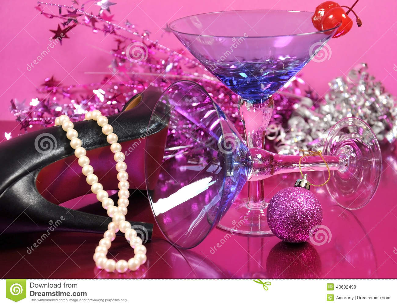pink theme happy new year party with vintage blue martini cocktail glass and new years eve