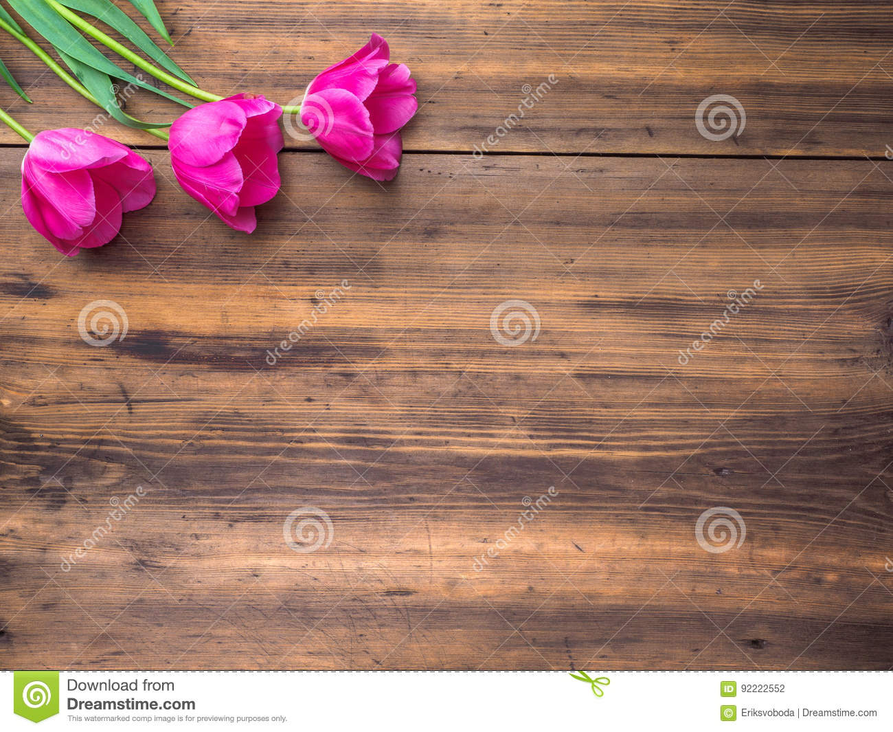 pink tulips floral arrangement on wooden background from old boards
