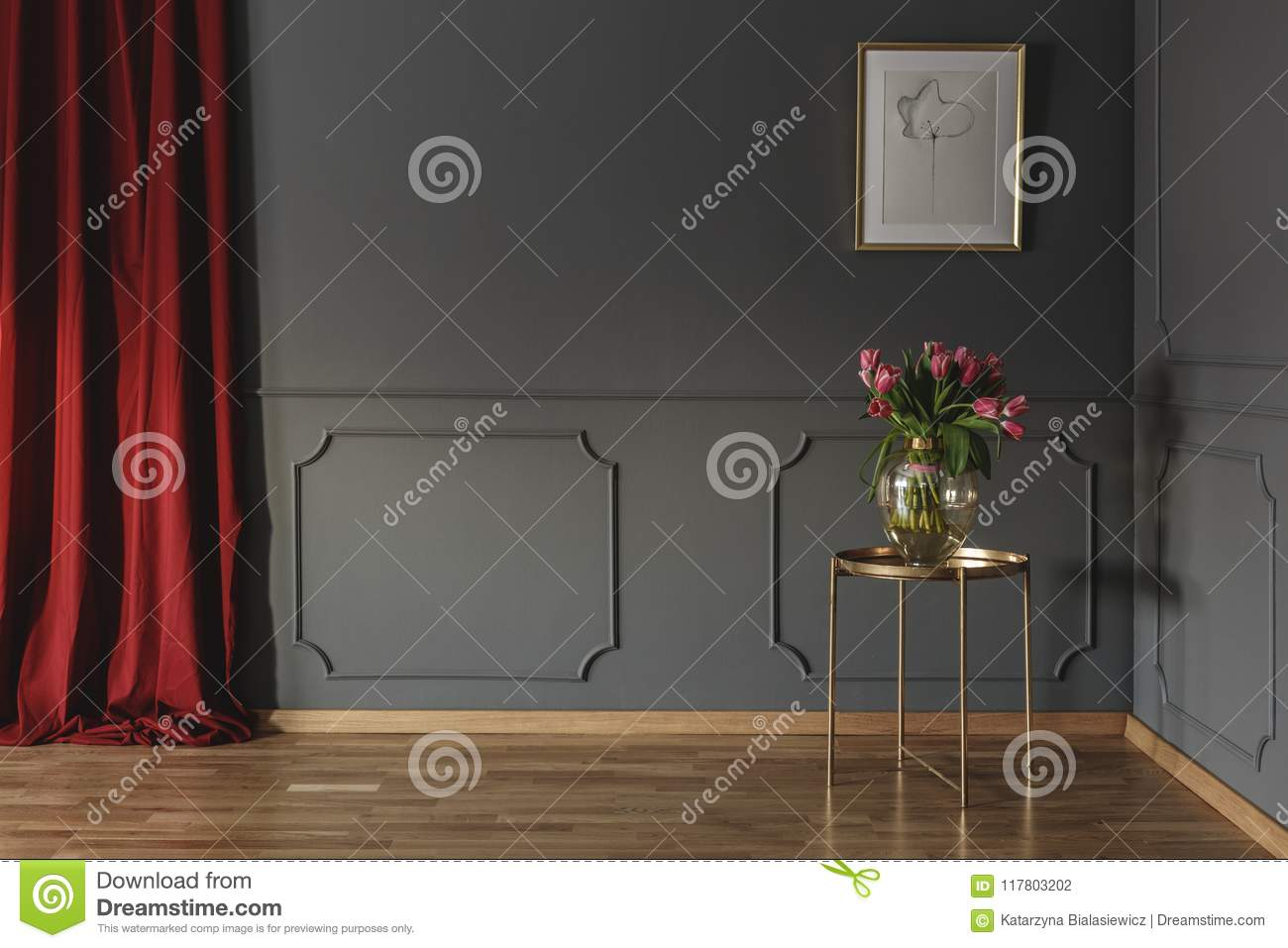 Pink tulips on a golden table in the corner of a luxurious inter