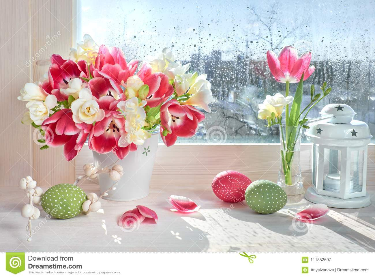 Pink Tulips And White Freesia Flowers With Easter Decorations On