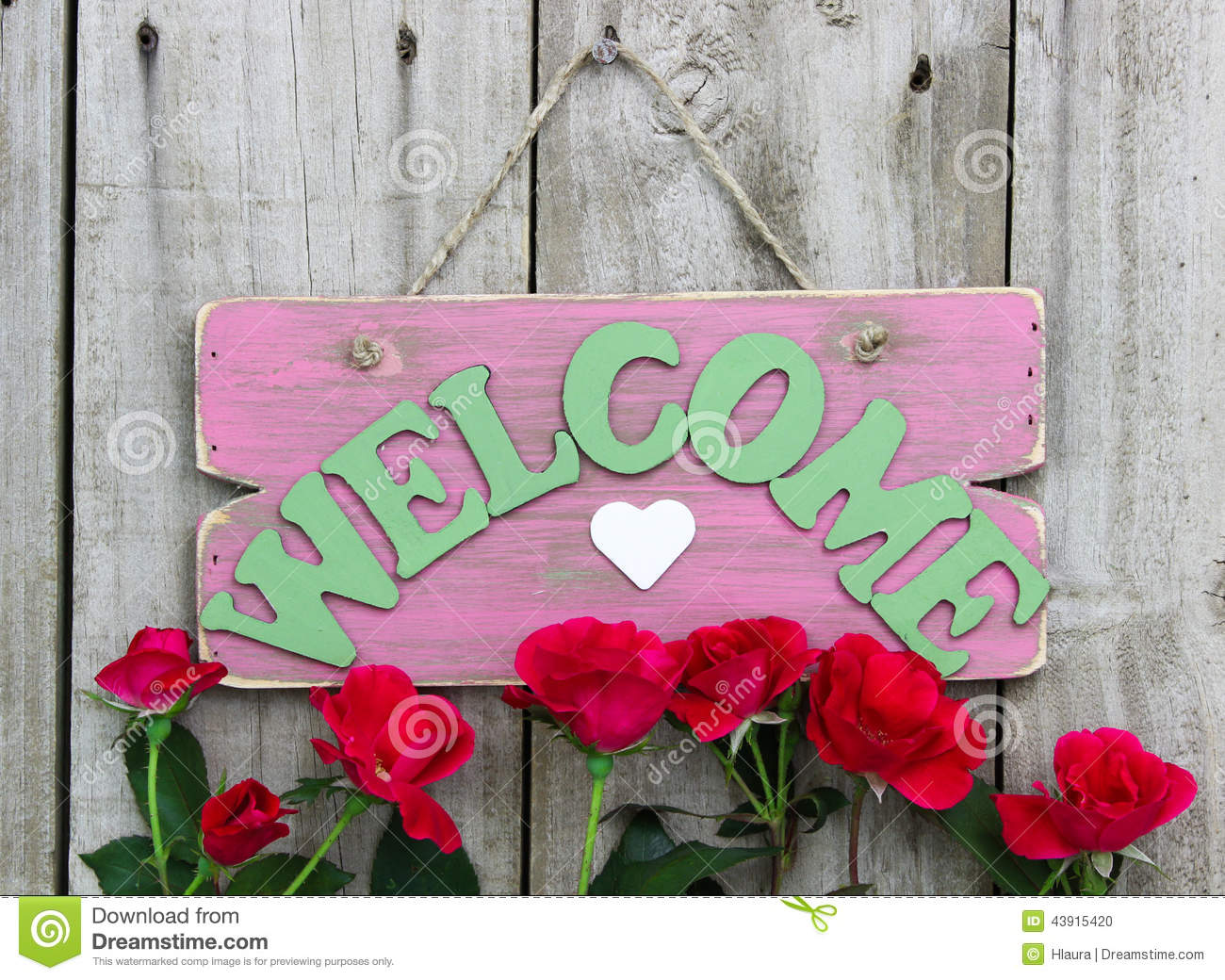 Pink Weathered Welcome Sign With Heart Hanging On Door