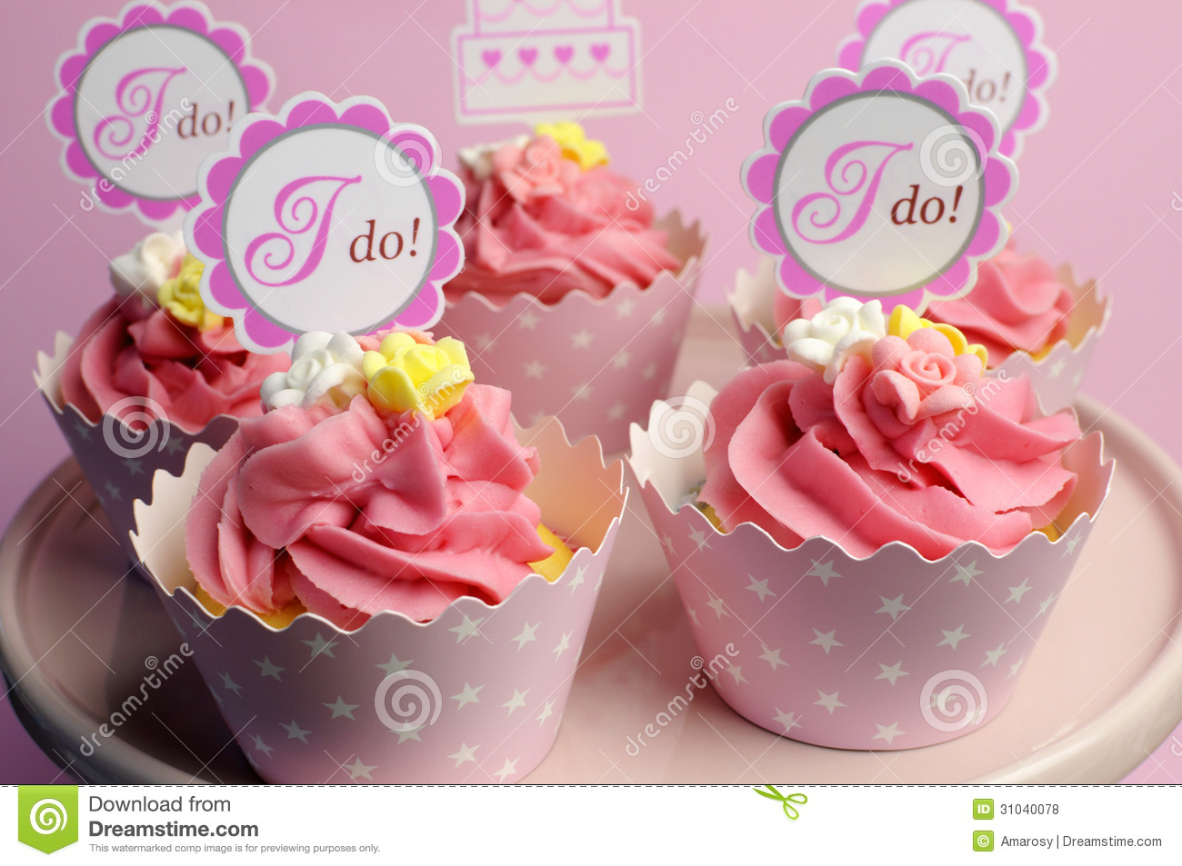 Pink Wedding Cupcakes With I Do Topper Signs - Horizontal. Stock ...