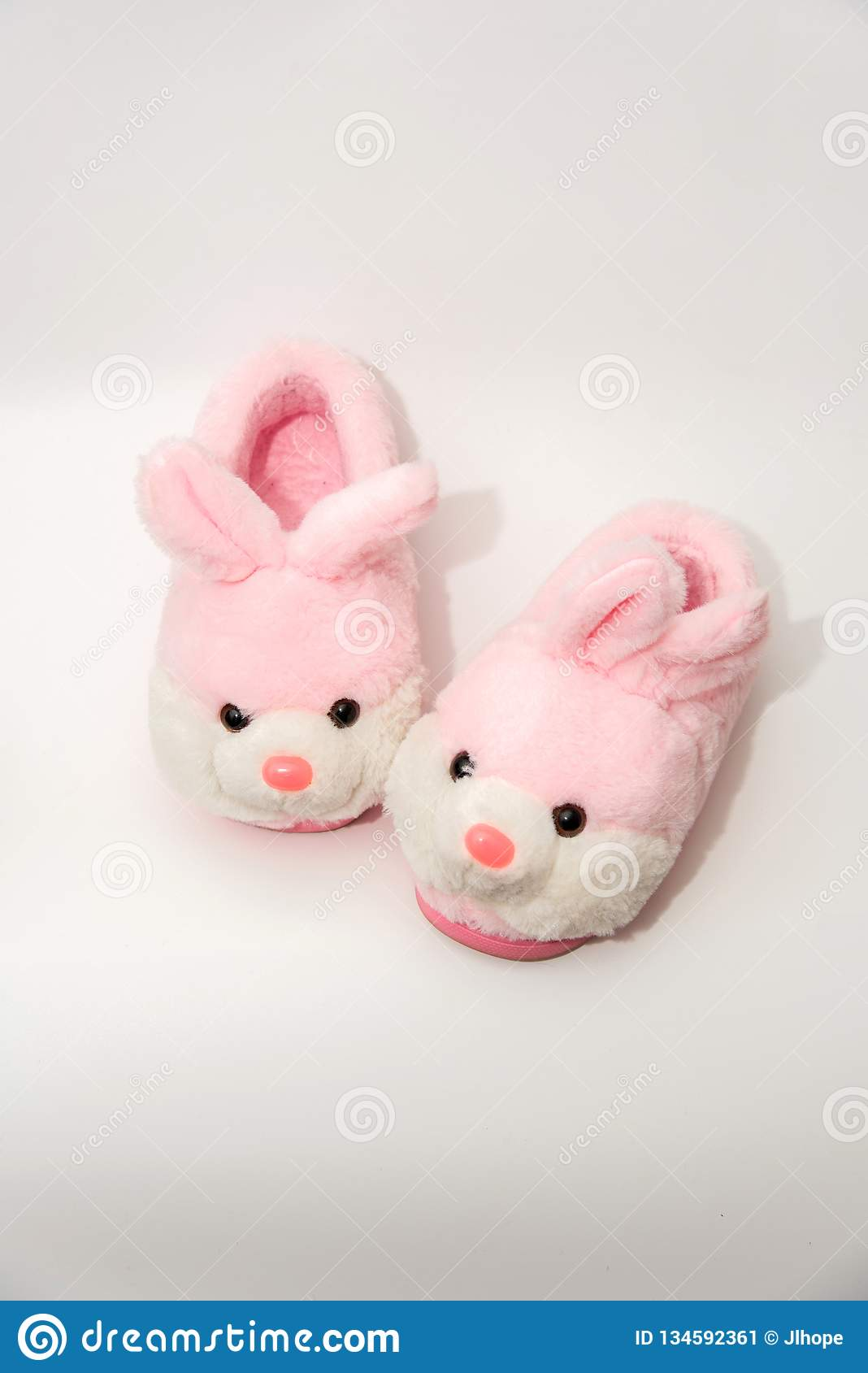 aa197223791c Cute pink and white rabbit shaped cotton-padded shoes isolated on white  background