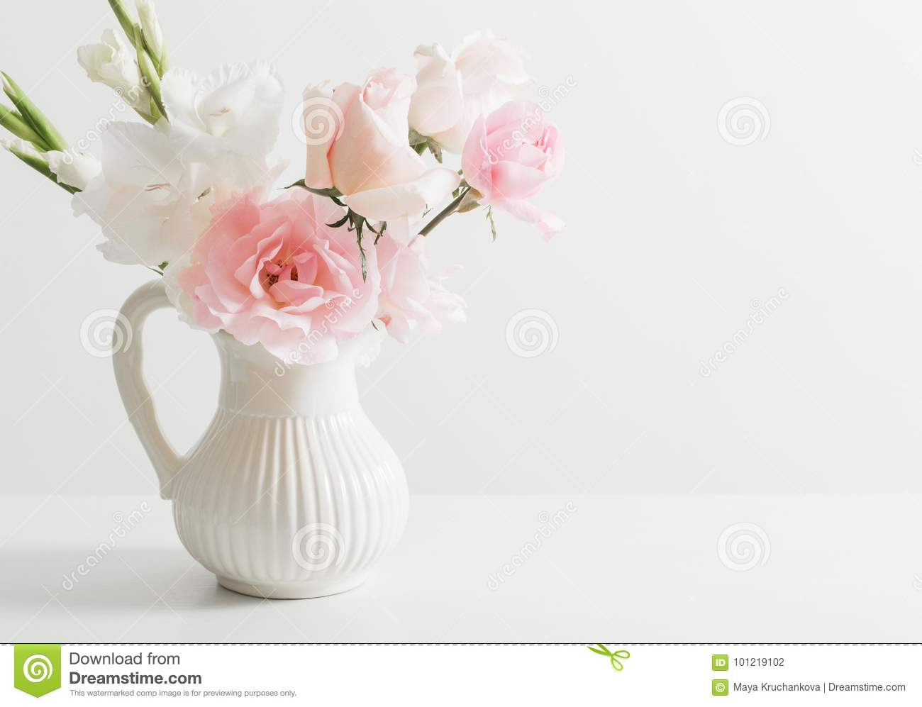 Pink And White Flowers In Vase On White Background Stock Photo