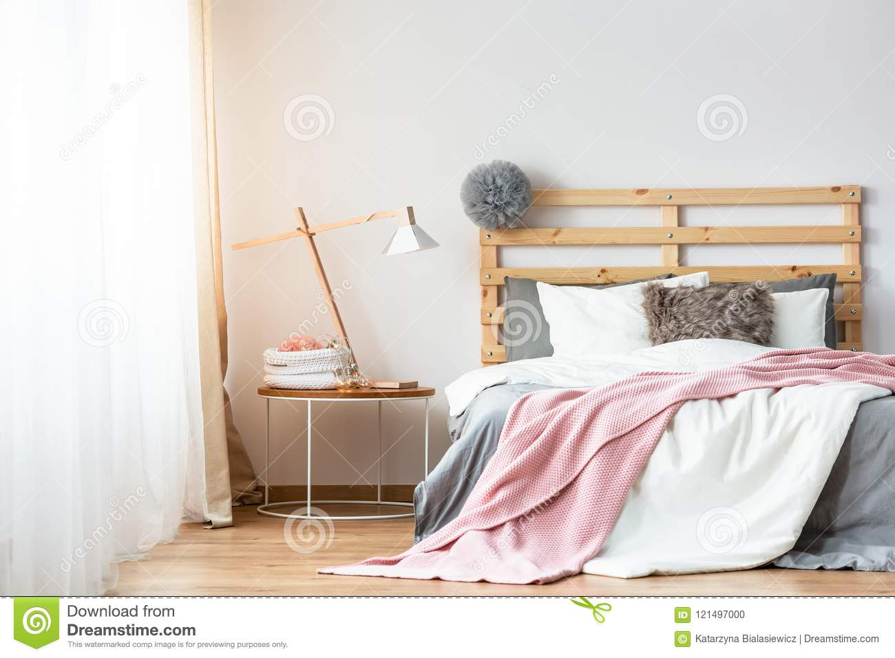 Pink And White Sheets On Wooden Bed Next To Table With Lamp In P Stock Photo Image Of Home Bedding 121497000