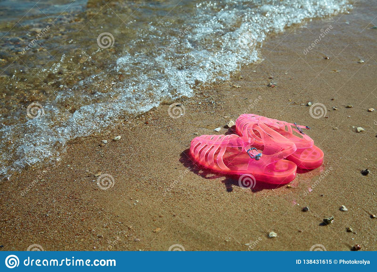 80dde9d16 Pink Women`s JELLY SANDALS on a sea shore. LADIES FLAT JELLIES SUMMER BEACH  SHOES. Sand background