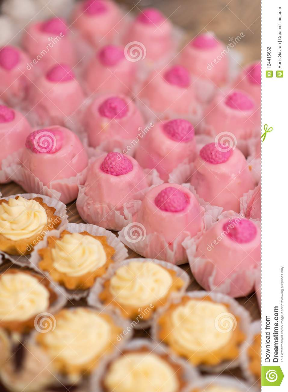 Pink And Yellow Cupcakes On Banquet Table. Stock Photo - Image of ...