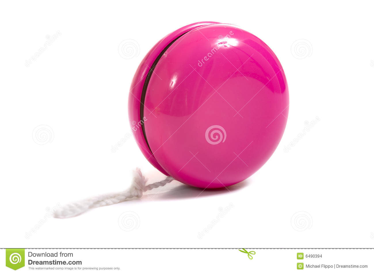 child's pink yo-yo on a white background with copy space.
