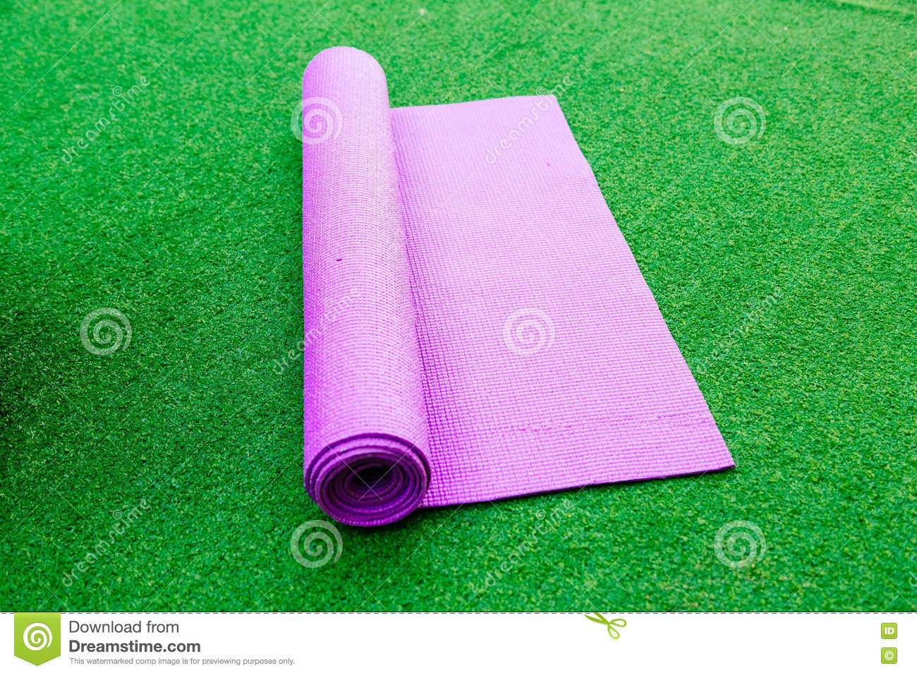 d58a421991570 Pink Yoga Mat On A Green Background Stock Image - Image of physical ...