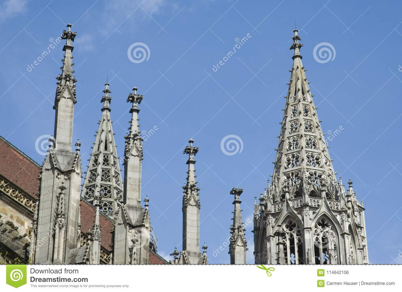 Eastern Spires Of Gothic Church In Ulm With Roof Tiles And Pinnacles Against Blue Sky