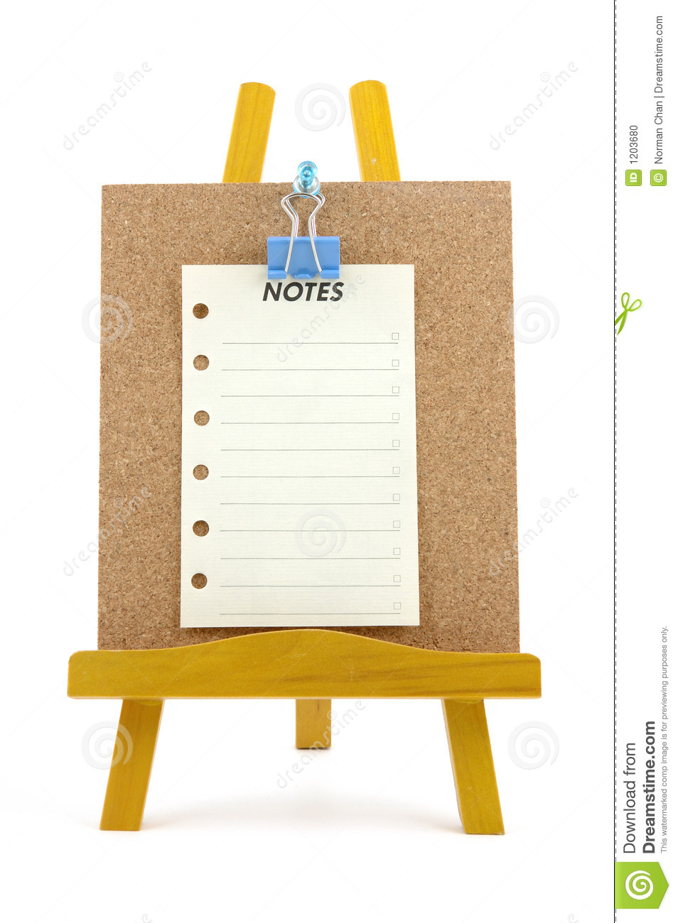 Pinned note on corkboard with wooden stand
