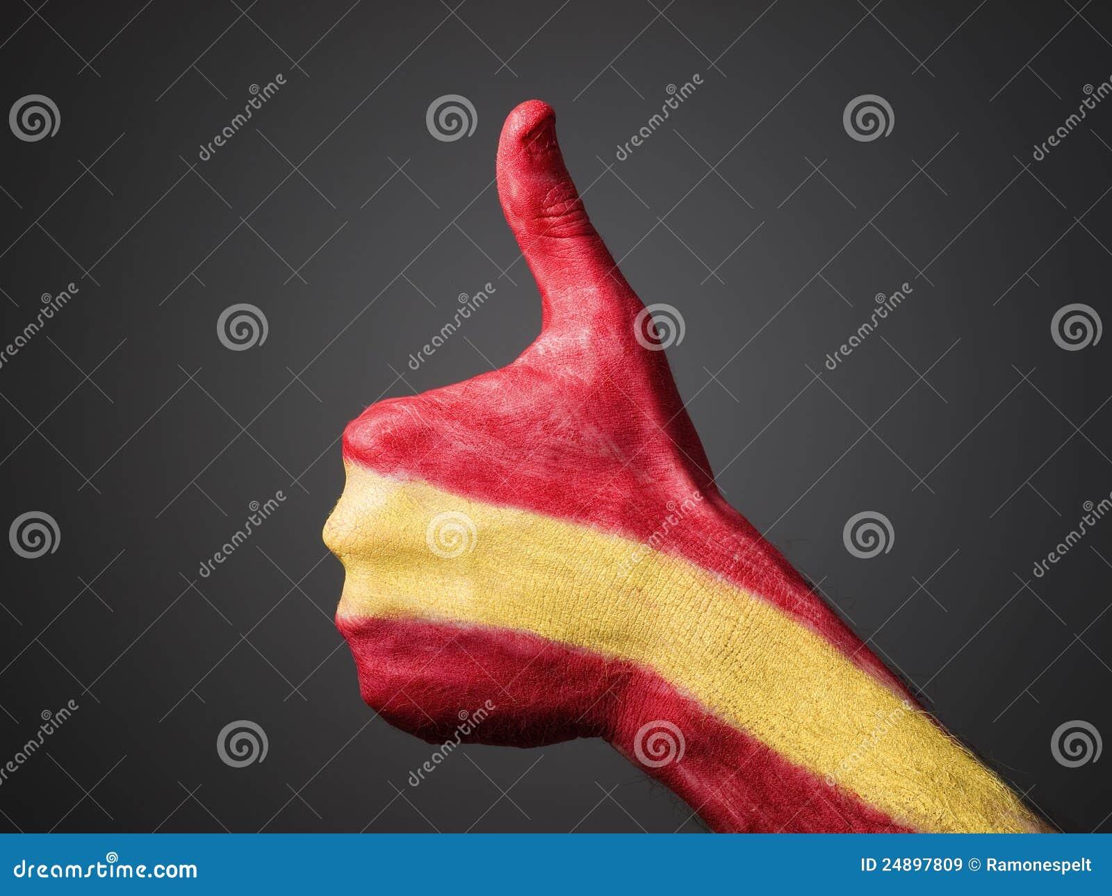 Pintado a mano con el indicador España que expresa positividad
